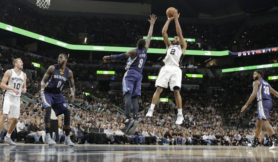 San Antonio Spurs forward Kawhi Leonard (2) shoots over Memphis Grizzlies forward James Ennis III (8) during the second half of Game 5 in a first-round NBA basketball playoff series, Tuesday, April 25, 2017, in San Antonio. San Antonio won 116-103. (AP Photo/Eric Gay)