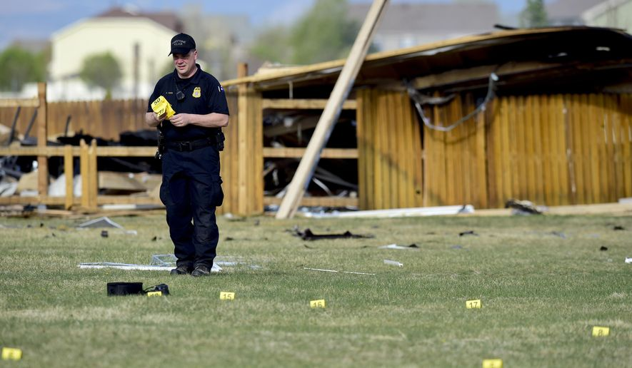 In this April 18, 2017, photo, an investigator with the Firestone Police places evidence markers on debris near a house that was destroyed in a deadly explosion in Firestone, Colo., on April 17. Anadarko Petroleum said Wednesday, April 26, that it operated a well about 200 feet (60 meters) from the house in the town of Firestone. The company didn't say whether the well was believed to be a factor in the explosion or whether it produced oil, gas or both. (Matthew Jonas/The Daily Times Call via AP)