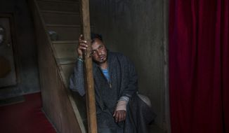 In this April 18, 2017 photo, Kashmiri man Farooq Ahmed Dar, takes a break in the middle to talking to the Associated Press at his residence in Chill village, about 60 Kilometers (38 miles) southwest of Srinagar, Indian controlled Kashmir. A viral video that showed the young shawl weaver Dar strapped to a patrolling Indian army jeep as a human shield against stone-throwing protesters incensed Kashmiris and sparked region wide debate. (AP Photo/Dar Yasin)