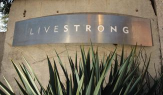 FILE - In this Jan. 13, 2013, file photo, a sign for the Livestrong Foundation is seen at the charity's headquarters in Austin, Texas. The Livestrong cancer charity continued its fundraising and contributions nosedive in 2015 for a third straight year after founder Lance Armstrong's performance-enhancing drug scandal, but foundation officials insist a rebound has already started. (AP Photo/Jack Plunkett, File)