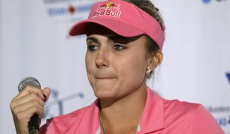 Lexi Thompson listens to a reporter's question about her recent tournament loss during a news conference Wednesday, April 26, 2017, in Irving, Texas. Thompson suffered a four-stroke penalty that cost her a major earlier this month after a spectator called in to point out the infraction. (AP Photo/LM Otero)