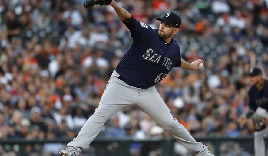 Seattle Mariners pitcher James Paxton throws against the Detroit Tigers in the second inning of a baseball game in Detroit, Wednesday, April 26, 2017. (AP Photo/Paul Sancya)