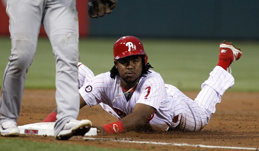 Philadelphia Phillies' Maikel Franco advances to third on a wild pitch during the second inning of the team's baseball game against the Miami Marlins, Wednesday, April 26, 2017, in Philadelphia. (AP Photo/Tom Mihalek)