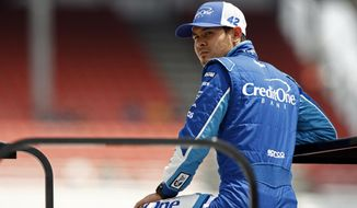 Driver Kyle Larson watches during practice for a NASCAR Xfinity Series auto race, Friday, April 21, 2017 in Bristol, Tenn. NASCAR officials announced because of weather, the field for Sunday's Monster Cup race will set by points. Larson is the current points leader and will be on the pole. (AP Photo/Wade Payne)