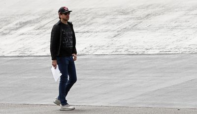 Driver Ryan Blaney looks over the track before a NASCAR Monster Energy NASCAR Cup Series auto race, Monday, April 24, 2017 in Bristol, Tenn. (AP Photo/Wade Payne)