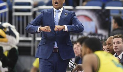 FILE - In this March 16, 2017, file photo, then-UNCW head basketball coach Kevin Keatts watches the action during a first round NCAA tournament game against Virginia at the Amway Center in Orlando, Fla. New North Carolina State coach Keatts says he's pursuing recruits who are the right fit for his system instead of bringing in players just to add numbers, even if that means having a shorter bench for his debut season. (Matt Born/The Star-News via AP, File)