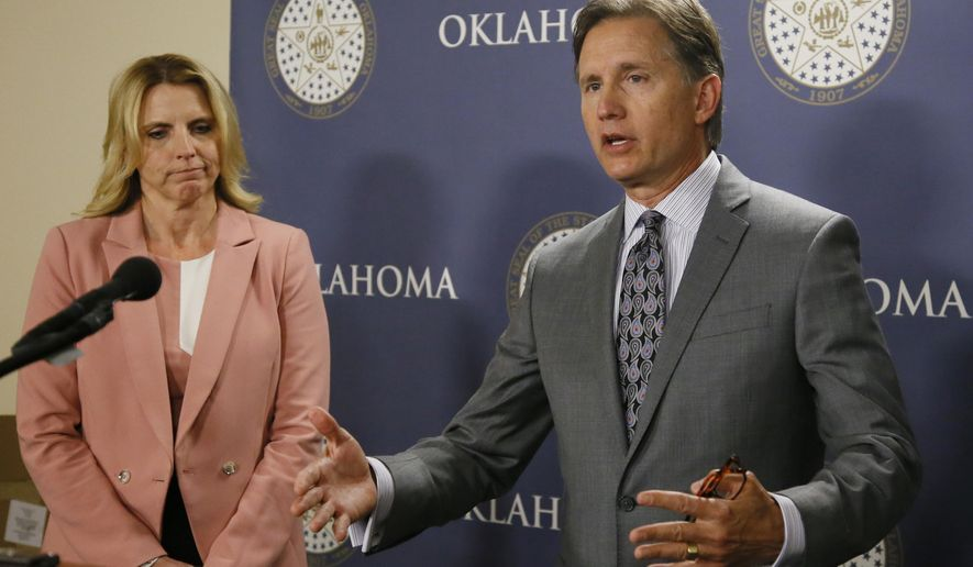 Oklahoma Attorney General Mike Hunter gestures as he speaks at a news conference regarding legislation to form the Oklahoma Commission on Opioid Abuse, in Oklahoma City, Wednesday, April 26, 2017. At left is state Sen. A.J. Griffin, R-Guthrie. (AP Photo/Sue Ogrocki)