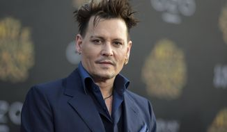 "FILE - In this May 23, 2016, file photo, Johnny Depp arrives at the premiere of ""Alice Through the Looking Glass"" at the El Capitan Theatre, in Los Angeles. Depp's former business managers called him a ""habitual liar"" in a statement on April 26, 2017. The managers were responding to Depp's criticism of them in The Wall Street Journal. (Photo by Richard Shotwell/Invision/AP, File)"