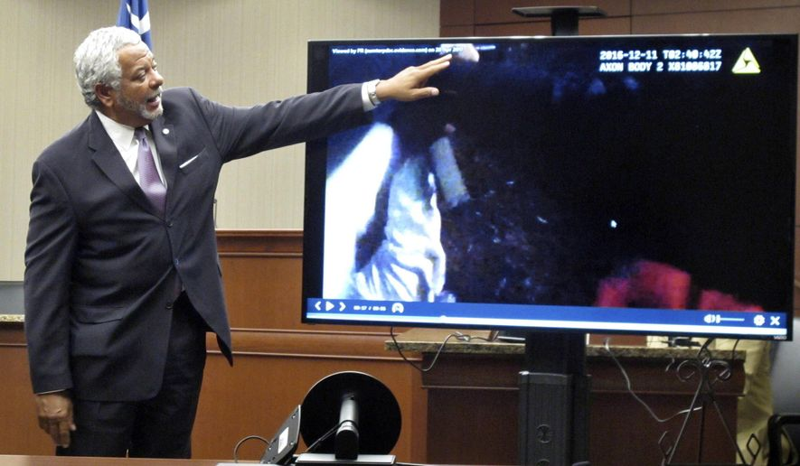Solicitor Chip Finney points to a gun, he said was in the hands of a man who was shot by Sumter police, during a Wednesday, April 26, 2017, news conference in Sumter, S.C..Finney said the officers were justified in killing Waltki Williams because he had a gun and did not charge them. (AP Photo/Jeffrey Collins)