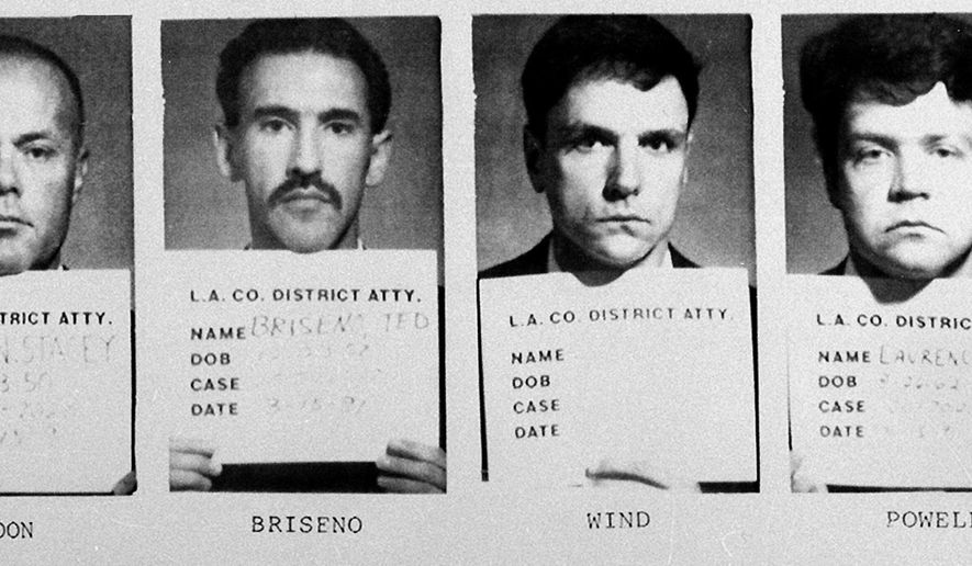FILE - This combination of March 14, 1991 booking photos shows the four police officers indicted for brutalizing black motorist Rodney King in a videotaped attack. From left are Sgt. Stacey C. Koon, Officer Theodore J. Briseno, Officer Timothy E. Wind and Officer Laurence Powell. Two served time in prison and all four lost their careers. (LA County District Attorney via AP)