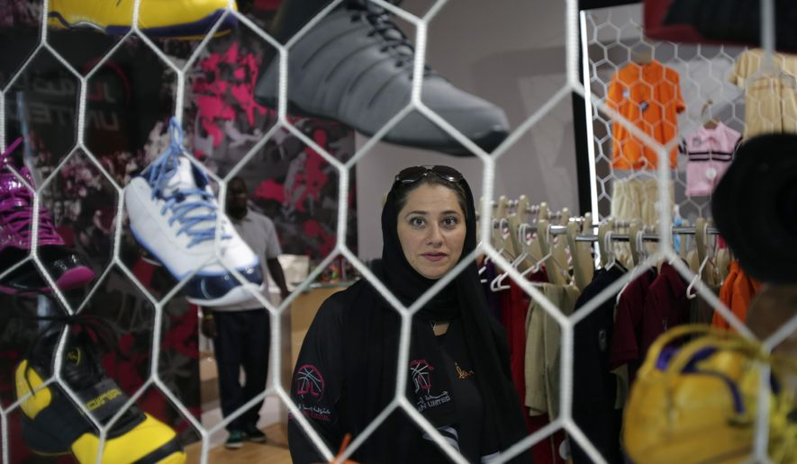 FILE- In this May 12, 2014 file photo, Jiddah United sports club founder Lina Almaeena stands in her sporting goods shop in Jiddah, Saudi Arabia. A proposal to establish physical education colleges in Saudi female has failed to win enough votes in the kingdom's Shura Council, which advises government. (AP Photo/Hasan Jamali, File)