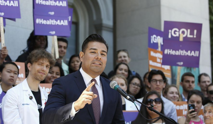 FILE - In this May 16, 2016, file photo, California state Sen. Ricardo Lara, D-Bell Gardens, speaks at a rally at the Capitol in Sacramento, Calif. California lawmakers are considering an audacious proposal that would substantially remake the state's health care system by eliminating insurance companies and guaranteeing coverage for everyone. Lara, who wrote the bill with Democratic Sen. Toni Atkins of San Diego, says they're working on details. (AP Photo/Rich Pedroncelli, File)