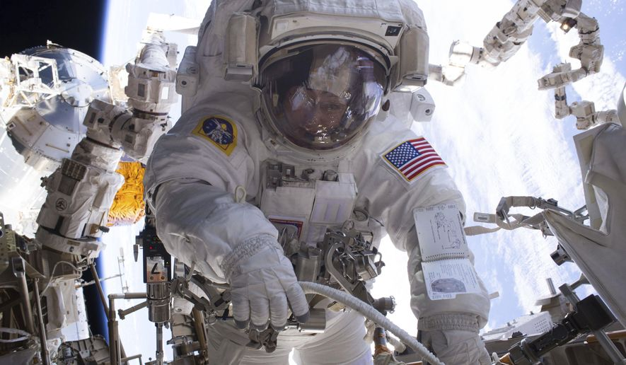 In this Jan. 6, 2017 photo made available by NASA, astronaut Peggy Whitson performs a spacewalk during Expedition 50 aboard the International Space Station. According to a report released Wednesday, April 26, 2017, NASA is managing a variety of design and health risks associated with the spacewalking suits used by astronauts aboard the International Space Station. The suits were developed more than 40 years ago and intended for only 15 years' use. (NASA via AP)