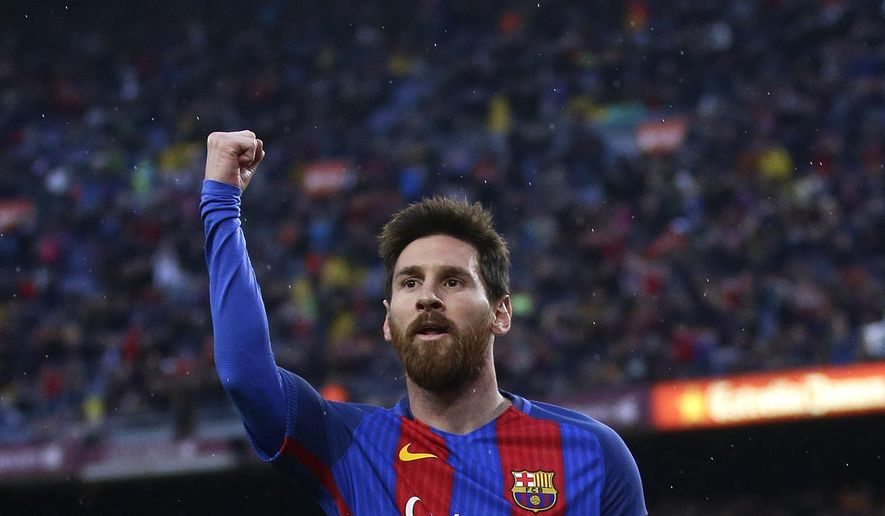 FC Barcelona's Lionel Messi celebrates after scoring during the Spanish La Liga soccer match between FC Barcelona and Osasuna at the Camp Nou stadium in Barcelona, Spain, Wednesday, April 26, 2017. (AP Photo/Manu Fernandez)