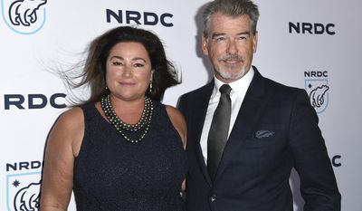 "Keely Shaye Smith, left, and Pierce Brosnan arrive at the ""STAND UP! for the Planet"" benefit at the Wallis Annenberg Center for the Performing Arts on Tuesday, April 25, 2017, in Beverly Hills, Calif. (Photo by Richard Shotwell/Invision/AP)"