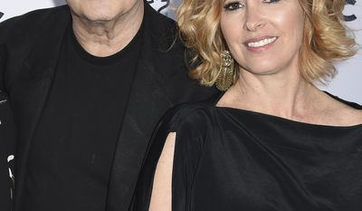 "Albert Brooks, left, and Kimberly Shlain arrive at the ""STAND UP! for the Planet"" benefit at the Wallis Annenberg Center for the Performing Arts on Tuesday, April 25, 2017, in Beverly Hills, Calif. (Photo by Richard Shotwell/Invision/AP)"