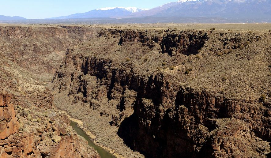 "FILE--This March 25, 2013, file aerial photograph shows the Rio Grande Gorge, looking north from the Taos Gorge Bridge, which is now part of the Rio Grande del Norte National Monument near Taos, N.M. President Donald Trump signed an executive order Wednesday, April 26, 2017, directing his interior secretary to review the designation of dozens of national monuments on federal lands, as he singled out ""a massive federal land grab"" by the Obama administration. (Dean Hanson/The Albuquerque Journal via AP, file)"