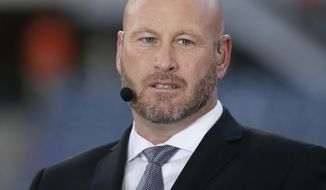 "FILE - In this Sept. 19, 2016, file photo, Trent Dilfer talks during ESPN's ""Monday Night Countdown"" before an NFL football game between the Chicago Bears and the Philadelphia Eagles, in Chicago. ESPN is laying off about 100 employees, including former athletes-turned-broadcasters Trent Dilfer, Len Elmore and Danny Kanell, in a purge designed to focus the sports network on a more digital future. The cuts will trim ESPN's stable of on-air talent and writers by about 10 percent. (AP Photo/Charles Rex Arbogast, File)"