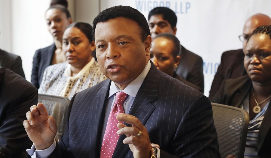 Fox News anchor Kelly Wright speaks during a news conference, Wednesday, April 26, 2017, in New York to discuss his part in a lawsuit accusing the network of allowing racial discrimination. Wright and ten former and current employees of Fox News Channel filed the suit on Tuesday, saying they repeatedly complained about an executive's racist behavior but no action was taken.  (AP Photo/Mark Lennihan)