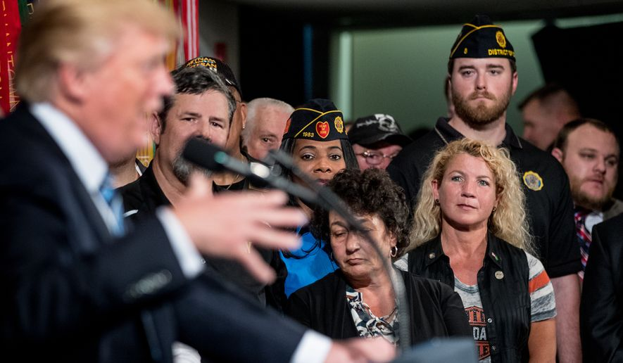"Veterans listen as President Donald Trump speaks before signing an Executive Order on ""Improving Accountability and Whistleblower Protection"" at the Department of Veterans Affairs, Thursday, April 27, 2017, in Washington. (AP Photo/Andrew Harnik)"