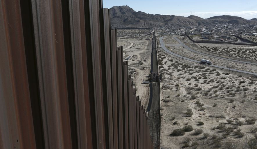 In this Wednesday, Jan. 25, 2017 file photo, a truck drives near the Mexico-US border fence, on the Mexican side, separating the towns of Anapra, Mexico and Sunland Park, New Mexico.  (AP Photo/Christian Torres, File)  **FILE**