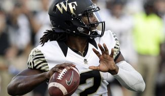 FILE - In this Saturday, Sept. 10, 2016, file photo, Wake Forest quarterback Kendall Hinton (2) passes against Duke during the second half of an NCAA college football game in Durham, N.C. Hinton is one of the players to keep an eye on when ACC schools begin preseason camp over the summer. (AP Photo/Gerry Broome, File)