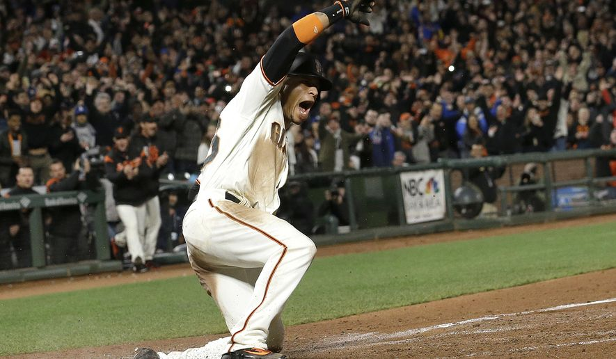San Francisco Giants' Gorkys Hernandez celebrates after scoring the winning run against the Los Angeles Dodgers during the 10th inning of a baseball game in San Francisco, Wednesday, April 26, 2017. The Giants won 4-3. (AP Photo/Jeff Chiu)