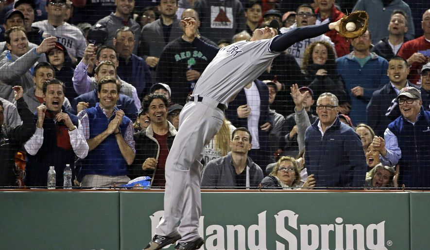 New York Yankees third baseman Chase Headley reaches back to snag a pop foul by Boston Red Sox's Xander Bogaerts during the eighth inning of a baseball game at Fenway Park, Thursday, April 27, 2017, in Boston. (AP Photo/Elise Amendola)