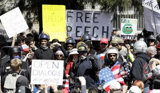 A crowd gathers around speakers during a rally for free speech Thursday, April 27, 2017, in Berkeley, Calif. Demonstrators gathered near the University of California, Berkeley campus amid a strong police presence and rallied to show support for free speech. (AP Photo/Marcio Jose Sanchez)
