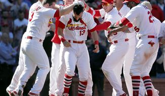 St. Louis Cardinals' Matt Carpenter (13) is congratulated by teammates after hitting a walk-off grand slam to defeat the Toronto Blue Jays 8-4 in 11 innings in the first baseball game of a doubleheader Thursday, April 27, 2017, in St. Louis. (AP Photo/Jeff Roberson)