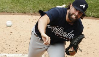 Atlanta Braves' R.A. Dickey delivers a pitch during the second inning of a baseball game against the New York Mets, Thursday, April 27, 2017, in New York. (AP Photo/Frank Franklin II)