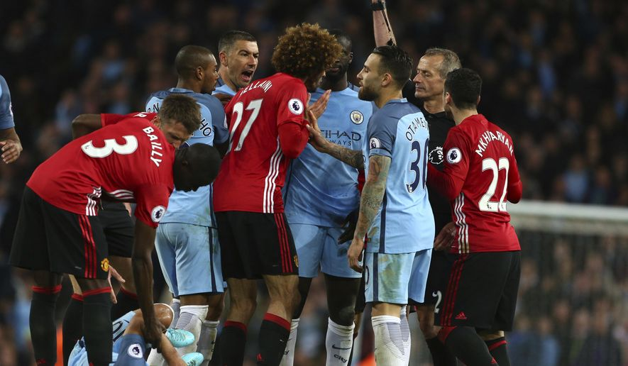 Manchester United's Marouane Fellaini, center, is sent off by given a red card during the English Premier League soccer match between Manchester City and Manchester United at the Etihad Stadium in Manchester, England,Thursday, April 27, 2017.(AP Photo/Dave Thompson)