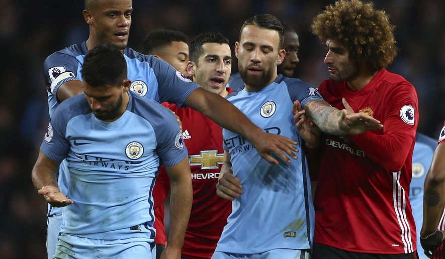 Manchester United's Marouane Fellaini, right, argues with Manchester City's Sergio Aguero, left, during the English Premier League soccer match between Manchester City and Manchester United at the Etihad Stadium in Manchester, England,Thursday, April 27, 2017.(AP Photo/Dave Thompson)