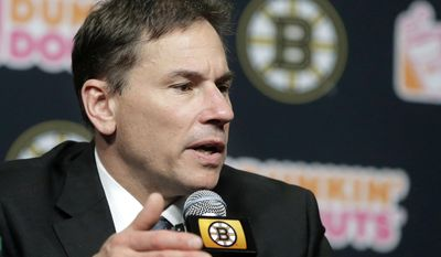 Boston Bruins head coach Bruce Cassidy takes questions from reporters during a news conference, Thursday, April 27, 2017, in Boston. The NHL hockey club are bringing Cassidy back next season, dropping the interim tag from his title as a reward for leading the team back to the playoffs for the first time in three seasons. (AP Photo/Steven Senne)