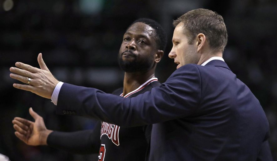 Chicago Bulls head coach Fred Hoiberg talks with guard Dwyane Wade during a break in the second quarter of a first-round NBA playoff basketball game against the Boston Celtics in Boston, Wednesday, April 26, 2017. (AP Photo/Charles Krupa)