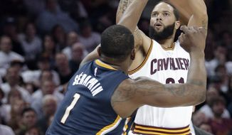 FILE - In this April 17, 2017, file photo, Cleveland Cavaliers' Deron Williams shoots over Indiana Pacers' Kevin Seraphin, from France, in the first half in Game 2 of a first-round NBA basketball playoff series, in Cleveland. Deron Williams looked lost for most of his first two months with the Cavaliers. The former All-Star guard found his way in the first round of the NBA playoffs, helping the defending champions sweep Indiana and showing that he might be a cure to the ills of their second unit. (AP Photo/Tony Dejak, File)