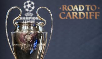 FILE - This Friday, March 17, 2017 file photo shows the Champions League trophy during the quarterfinal draw of the UEFA Champions League 2016/17 at the UEFA headquarters, in Nyon, Switzerland. Hotels in Cardiff are completely full for the night of the June 3 UEFA showpiece, even before the semifinals have been played. (Jean-Christophe Bott/Keystone via AP)