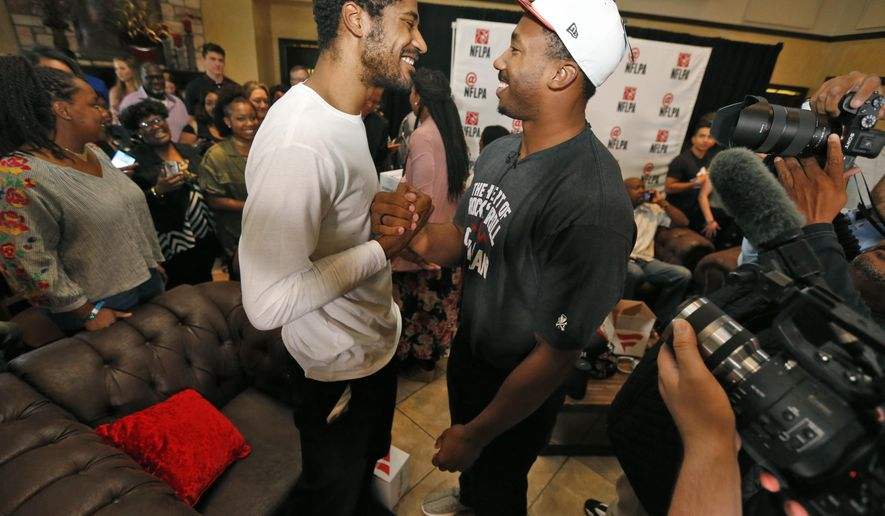 Texas A&M's Myles Garrett, right, is congratulated by his brother and former NBA player Sean Williams after the Cleveland Browns selected Garrett with the No. 1 pick in the NFL football draft, at Terre Verde Golf Course in Arlington, Texas, Thursday, April 27, 2017. (Nathan Hunsinger/The Dallas Morning News via AP)