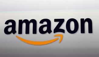 This Sept. 6, 2012, photo shows the Amazon logo in Santa Monica, Calif. Amazon.com Inc. reports financial earnings Thursday, April 27, 2017. (AP Photo/Reed Saxon, File)