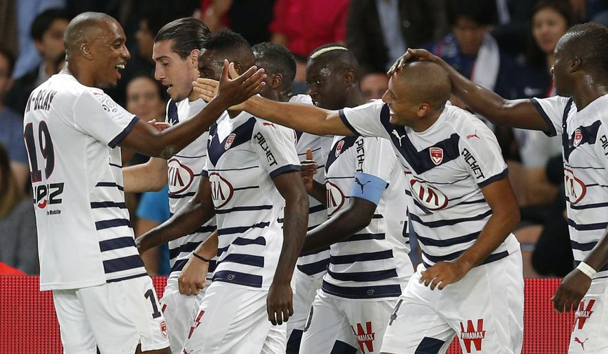 FILE - In this Friday Sept. 11, 2015 file photo, Bordeaux players celebrate a goal during the French league one soccer match between Paris Saint Germain and Bordeaux, in Paris, France. After several unimpressive seasons in the French league, Bordeaux is on its way to its best result since winning the title in 2009. With four matches left to play this 2016-17 season, Bordeaux is in fourth place in the league standings, one point above seven-time champion Lyon.  (AP Photo/Christophe Ena, File)
