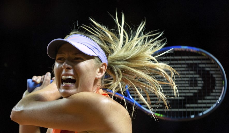 Maria Sharapova of Russia plays a return to Italy's Roberta Vinci during the Grand Prix tennis tournament in Stuttgart, Germany, Wednesday, April 26, 2017. Sharapova was given a lukewarm welcome by 4,500 spectators upon her return to professional tennis on Wednesday after a 15-month doping ban. (Daniel Maurer/dpa via AP)