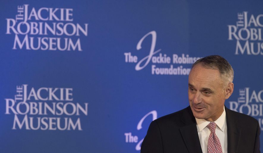 Major League Baseball Commissioner Robert D. Manfred, Jr. speaks during a ceremonial ground breaking for the Jackie Robinson Museum, Thursday, April 27, 2017, in New York. (AP Photo/Mary Altaffer)