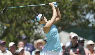 Lexi Thompson watches her tee shot on the 10th hole during the LPGA Texas Shootout golf tournament in Irving, Texas, Thursday, April 27, 2017. (AP Photo/LM Otero)