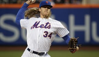 """FILE - In this April 20, 2017, file photo, New York Mets' Noah Syndergaard delivers a pitch during the first inning of a baseball game against the Philadelphia Phillies, in New York. Syndergaard was scratched from his start Thursday, April 27, 2017, against the Atlanta Braves because of what manager Terry Collins said was """"minor discomfort"""" in his bicep.(AP Photo/Frank Franklin II, File)"""