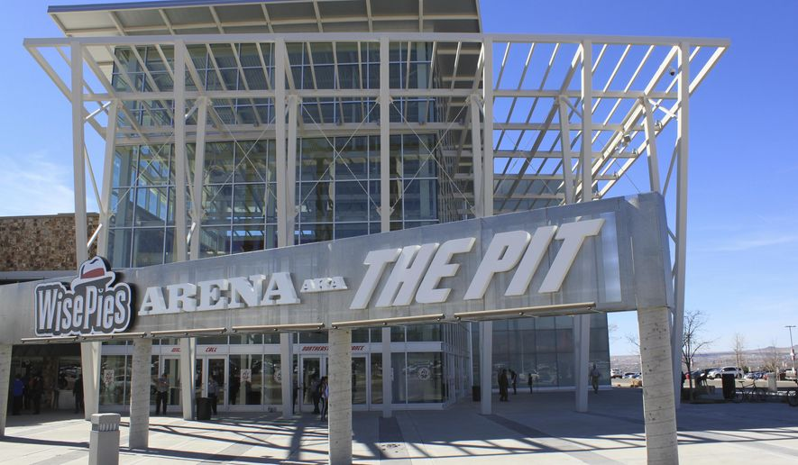 FILE- In this March 8 2017, file photo, this image shows the University of New Mexico arena, known as The Pit, in Albuquerque, N.M. The University of New Mexico has asked WisePies Pizza & Salad to give up the naming right to the arena where the school's men's and women's basketball teams play. The school said Thursday, April 27, that it recently asked the pizza chain to abandon its naming rights of The Pit pending a new agreement with another company (AP Photo/Susan Montoya Bryan, File)
