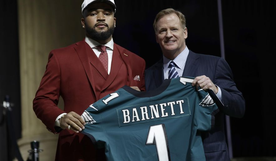 Tennessee's Derek Barnett, left, poses with NFL commissioner Roger Goodell after being selected by the Philadelphia Eagles during the first round of the 2017 NFL football draft, Thursday, April 27, 2017, in Philadelphia. (AP Photo/Matt Rourke)