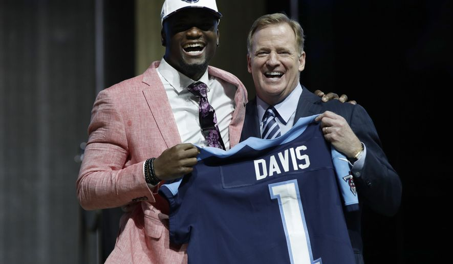 Western Michigan's Corey Davis, left, poses with NFL commissioner Roger Goodell after being selected by the Tennessee Titans during the first round of the 2017 NFL football draft, Thursday, April 27, 2017, in Philadelphia.(AP Photo/Matt Rourke)