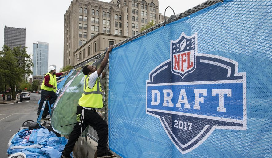 Workers make preparations ahead of the 2017 NFL football draft, in Philadelphia, Wednesday, April 26, 2017. (AP Photo/Matt Rourke)