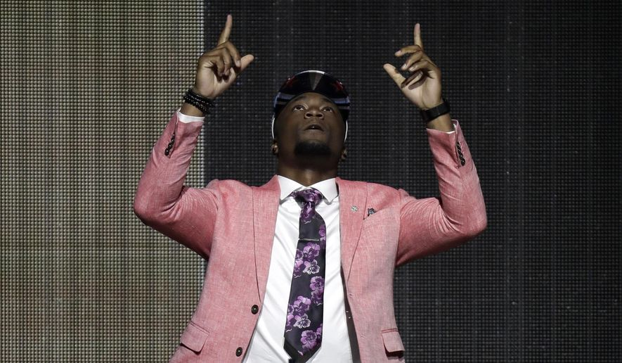 Western Michigan's Corey Davis reacts after being selected by the Tennessee Titans during the first round of the 2017 NFL football draft, Thursday, April 27, 2017, in Philadelphia. (AP Photo/Julio Cortez)