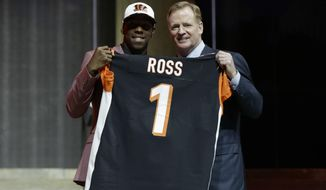 Washington's John Ross, left, poses with NFL commissioner Roger Goodell after being selected by the Cincinnati Bengals during the first round of the 2017 NFL football draft, Thursday, April 27, 2017, in Philadelphia. (AP Photo/Matt Rourke)